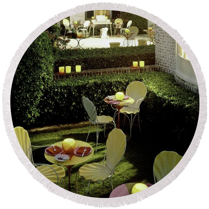 Furniture Round Beach Towel featuring the photograph Chairs And Tables In A Garden by Ernst Beadle