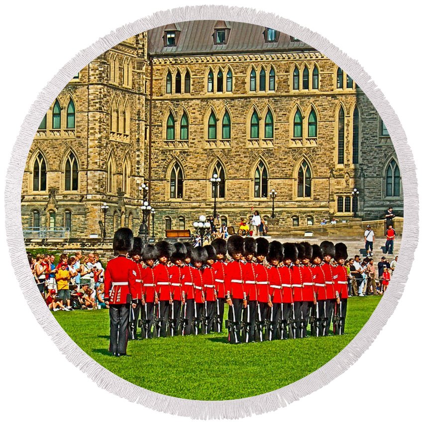 Changing Of The Guard In Front Of The Parliament Building In Ottawa Round Beach Towel featuring the photograph Changing Of The Guard In Front Of The Parliament Building In Ottawa-on by Ruth Hager