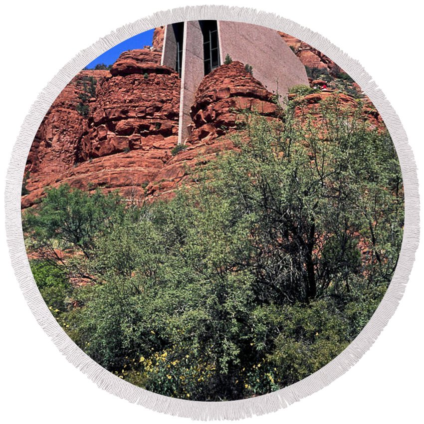 Chapel Of The Holy Cross Round Beach Towel featuring the photograph Chapel In Red Rocks by Sally Weigand
