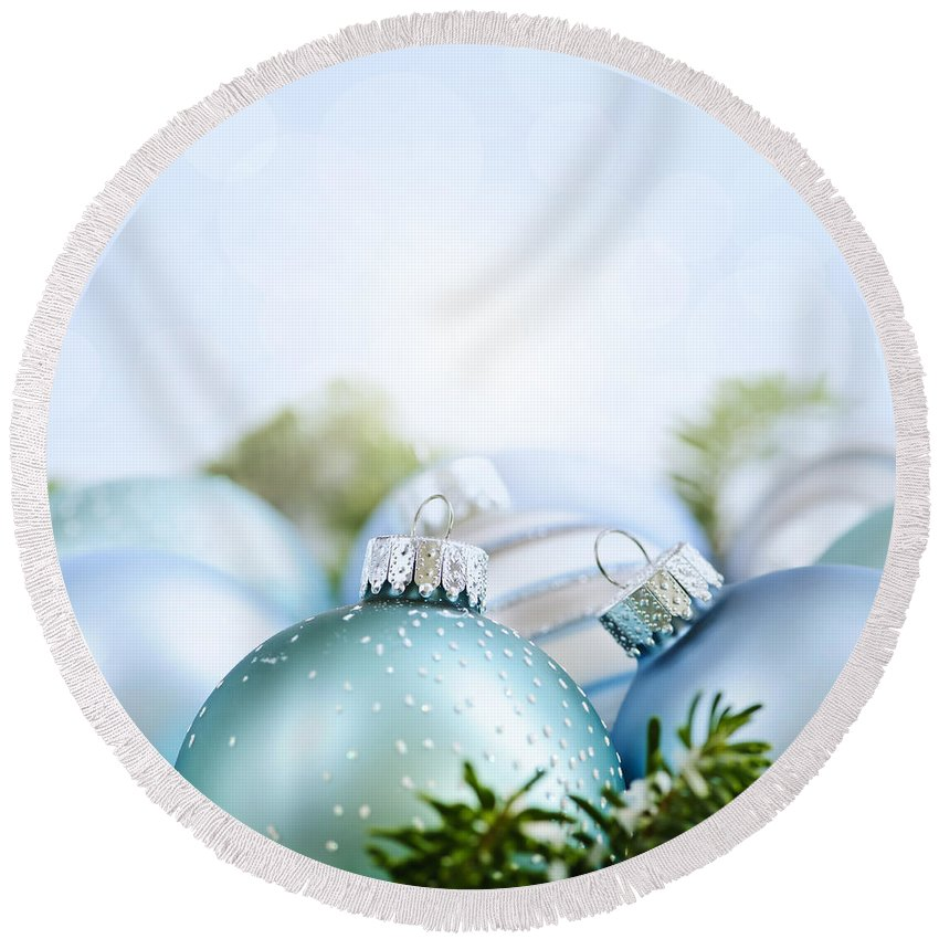 Christmas Round Beach Towel featuring the photograph Christmas Ornaments On Blue by Elena Elisseeva