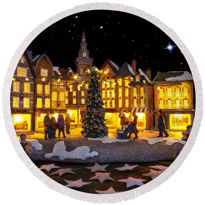 Advent; Architecture; Beautiful; Bedford; Bows; Building; Characters; Christmas; Church; Colorful; Commons; Composite; Dark; Decoration; Display; Exterior; Facade; Fake; Festive; Glow; Holiday; Home; Horizontal; Houses; Illumination; Inside; Lanterns; Lights; Lit; Moon; Night; Puppets; Scene; Scenic; Season; Small; Snow; Square; Stars; Statue; Street; Town; Travel; Trees; Vacations; Village; White; Windows; Winter; Yellow; Round Beach Towel featuring the photograph Christmas Village by Semmick Photo