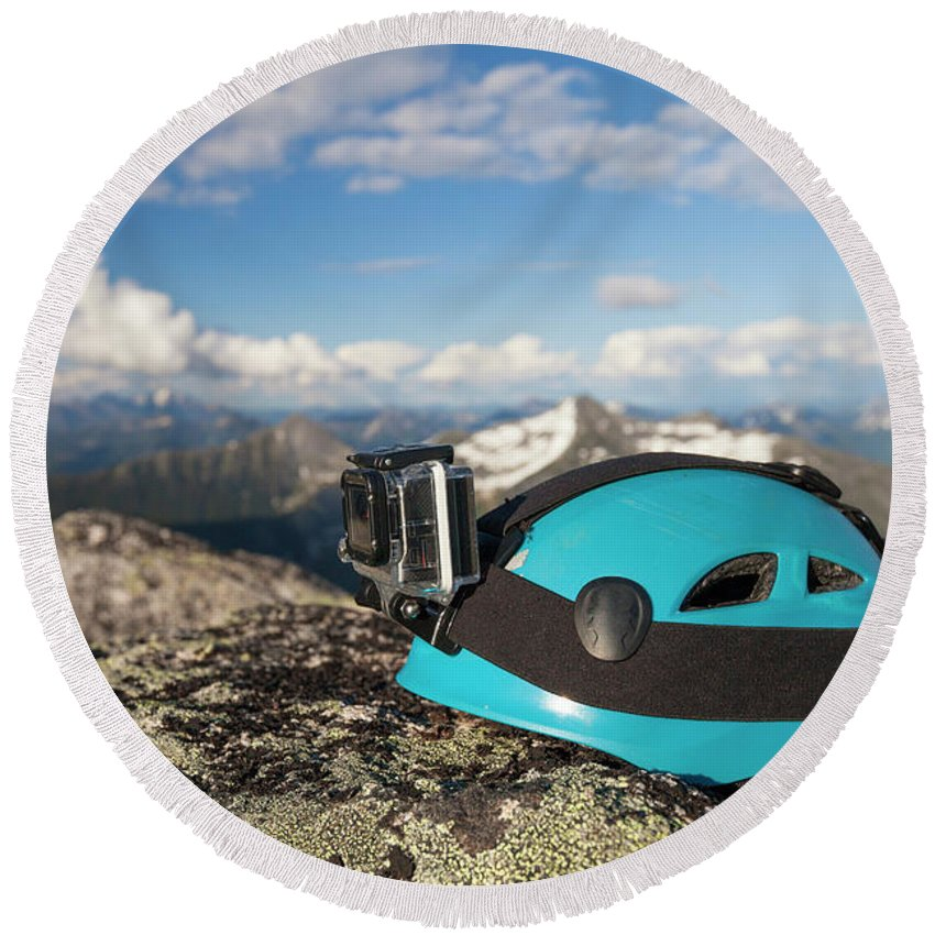 Safety Helmet Round Beach Towel featuring the photograph Climbing Helmet With Camera On Mountain by Christopher Kimmel