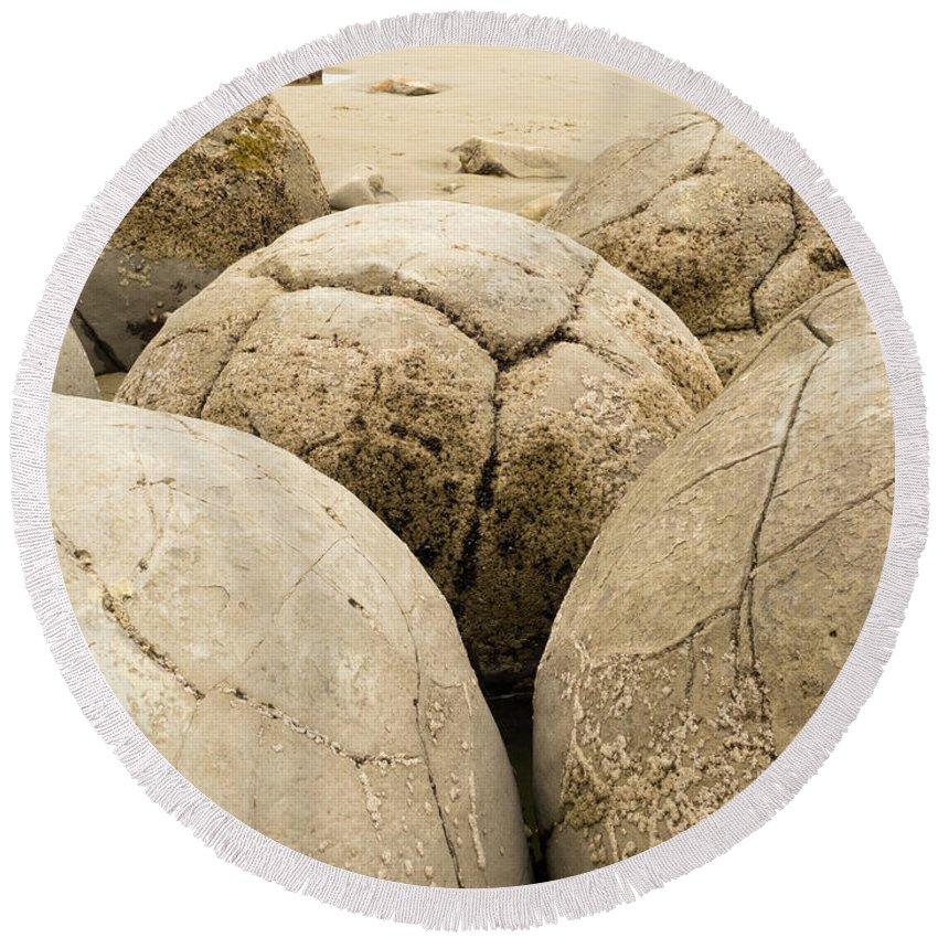 South Island Round Beach Towel featuring the photograph Closeup Of Famous Spherical Moeraki Boulders Nz by Stephan Pietzko