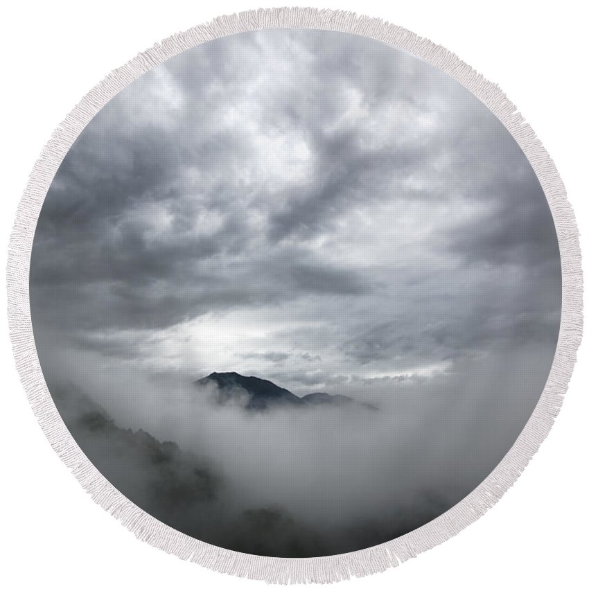 Mountain Round Beach Towel featuring the photograph Clouds And Mountain by Mats Silvan