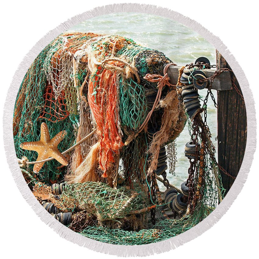 Fishing Net Round Beach Towel featuring the photograph Colorful Catch - Starfish In Fishing Nets by Gill Billington