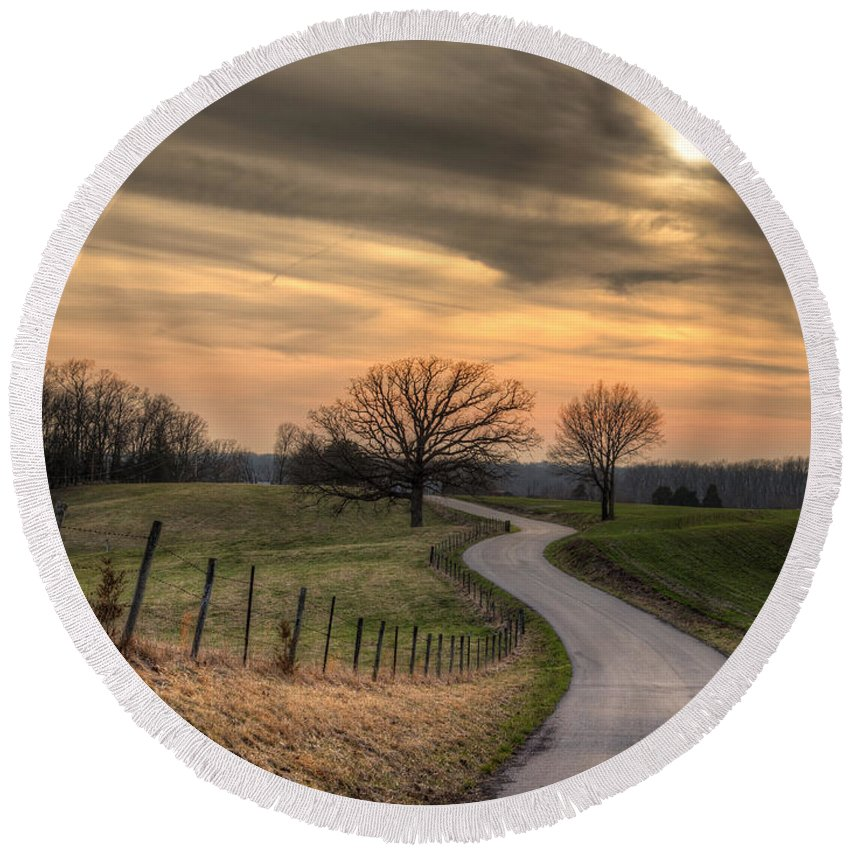 2014 Round Beach Towel featuring the photograph Country Road At Sunset by Larry Braun