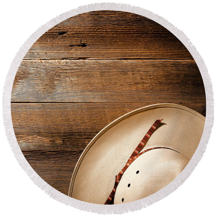 Aged Round Beach Towel featuring the photograph Cowboy Hat On Wood by American West Decor By Olivier Le Queinec