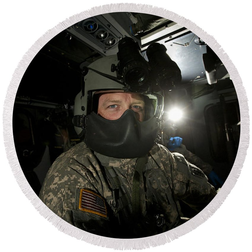Exercise Angel Thunder Round Beach Towel featuring the photograph Crew Chief In A Uh-60 Black Hawk by Terry Moore