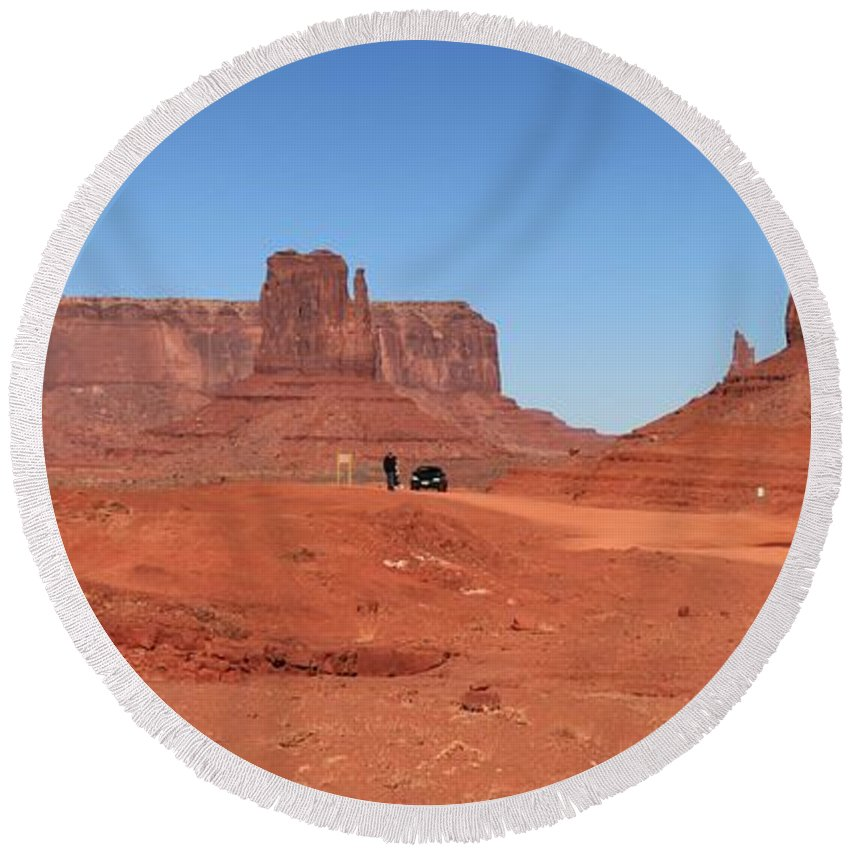 Monument Valley Round Beach Towel featuring the photograph Dwarfed by Adam Jewell
