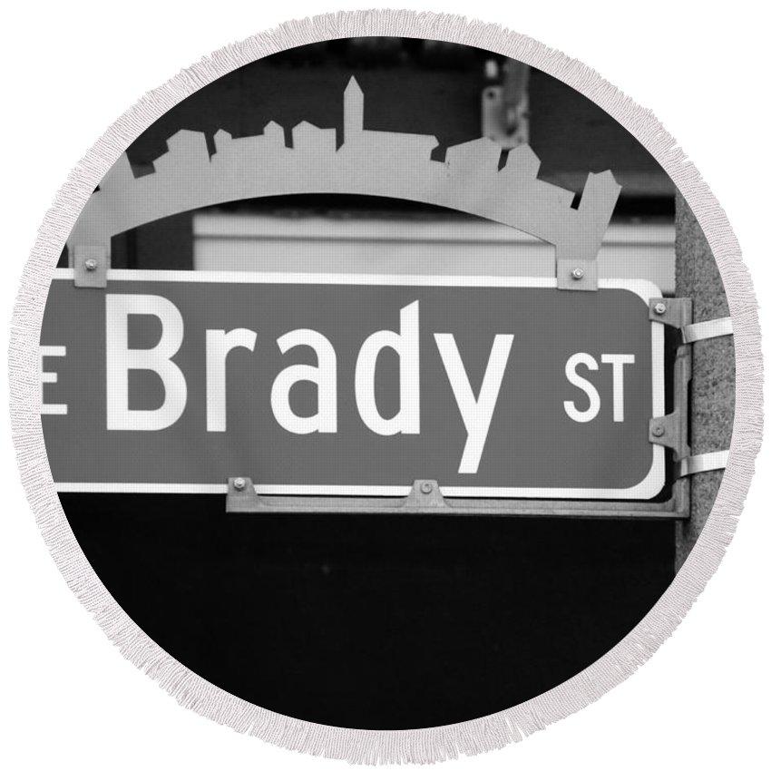 Brady Street Round Beach Towel featuring the photograph E Brady St by Debbie Nobile