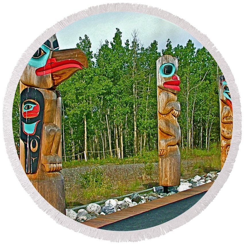 Edward Smarch Totem Poles At Teslin Tlingit Heritage Memorial Centre Round Beach Towel featuring the photograph Edward Smarch Totem Poles At Teslin Tlingit Heritage Memorial Center In Teslin-yt by Ruth Hager