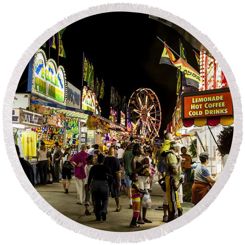 Carnival Round Beach Towel featuring the photograph Fairgoers Walk The Midway At Night At A County Fair by William Kuta