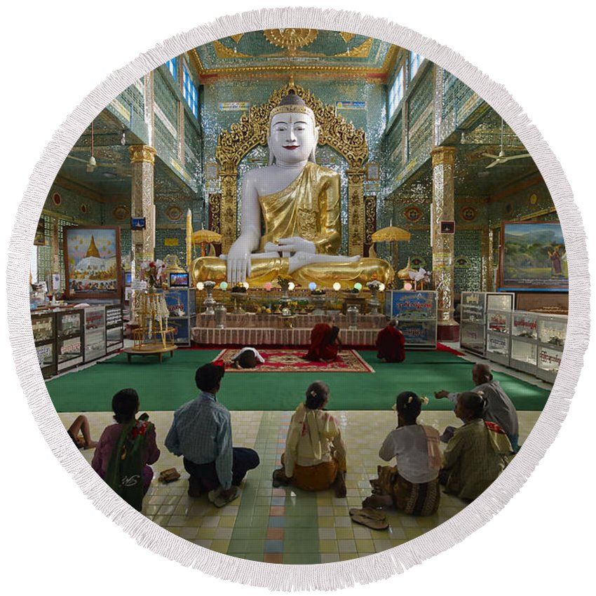 Sagain Round Beach Towel featuring the photograph faithful Buddhists praying at sitting Buddha in golden Ponnya Shin Pagoda by Juergen Ritterbach