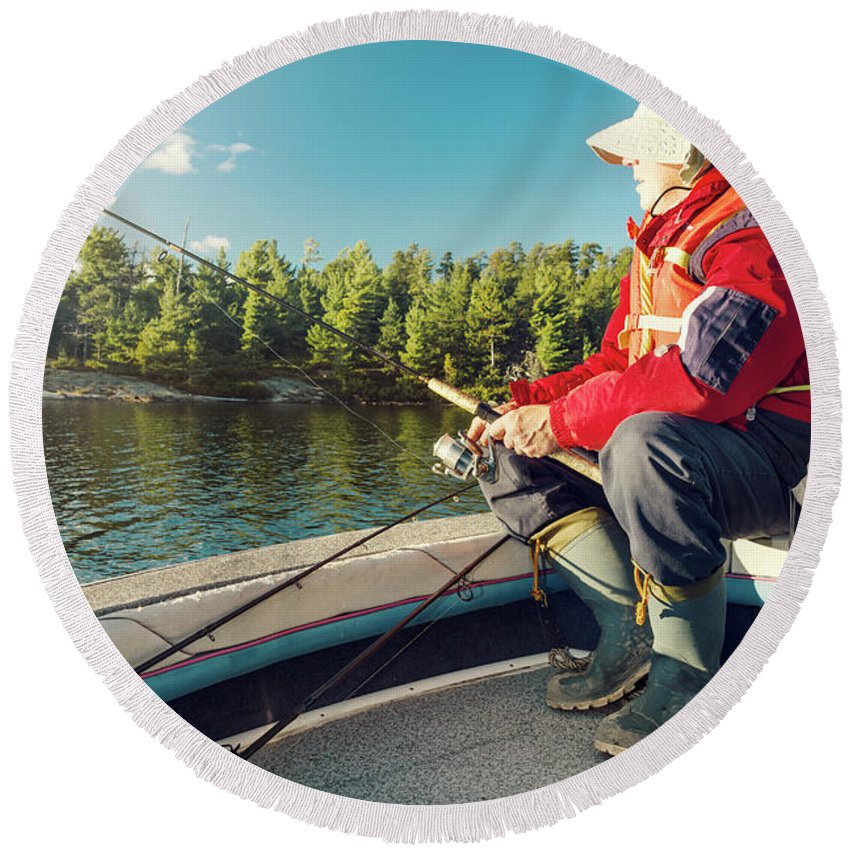 Hobbies Round Beach Towel featuring the photograph Fisherman Sitting On Foredeck by Marko Radovanovic