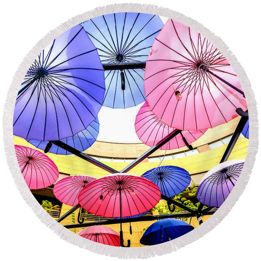 Parasol Round Beach Towel featuring the photograph Floating Umbrella by Jijo George
