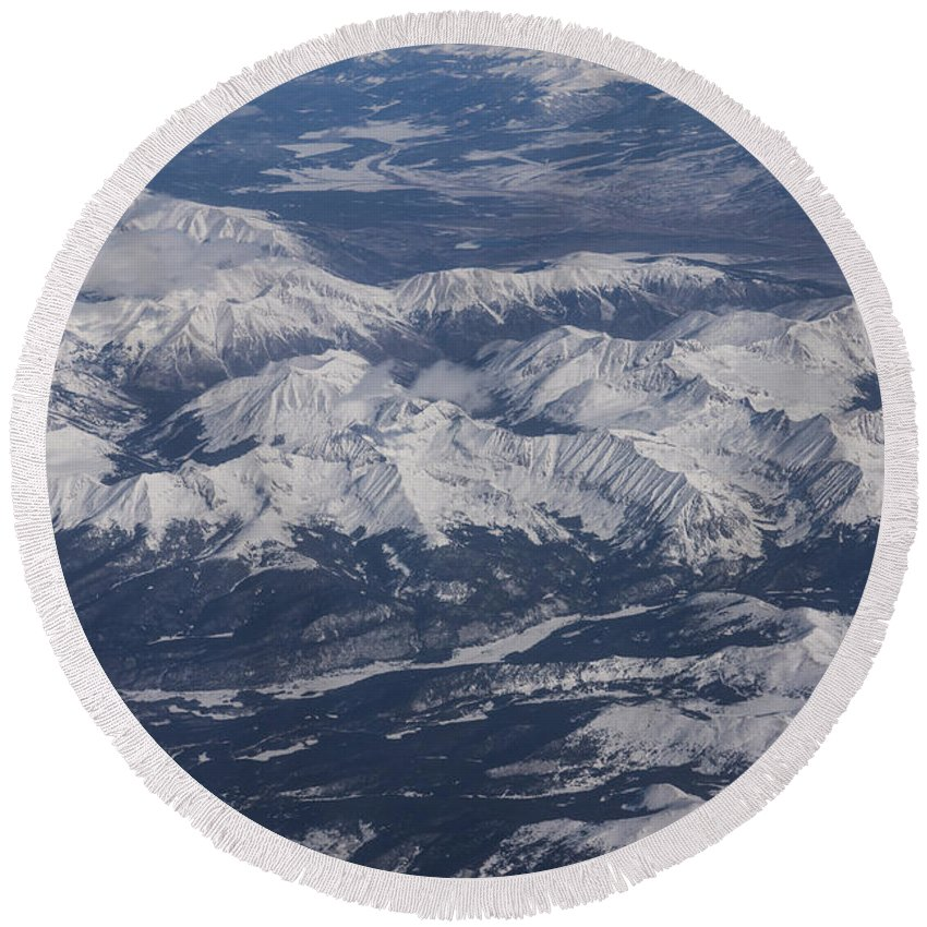Rocky Mountains Round Beach Towel featuring the photograph Flying Over The Snow Covered Rocky Mountains by Georgia Mizuleva