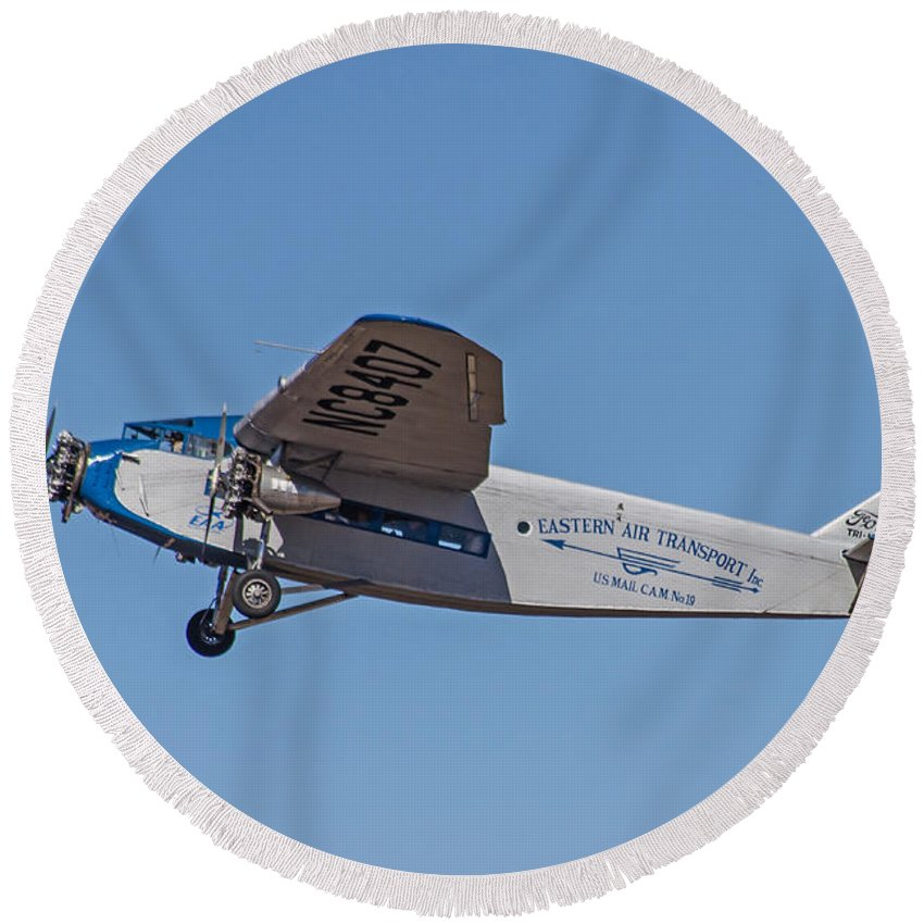 Airplane Round Beach Towel featuring the photograph Ford Tri-motor In Flight by Allen Sheffield