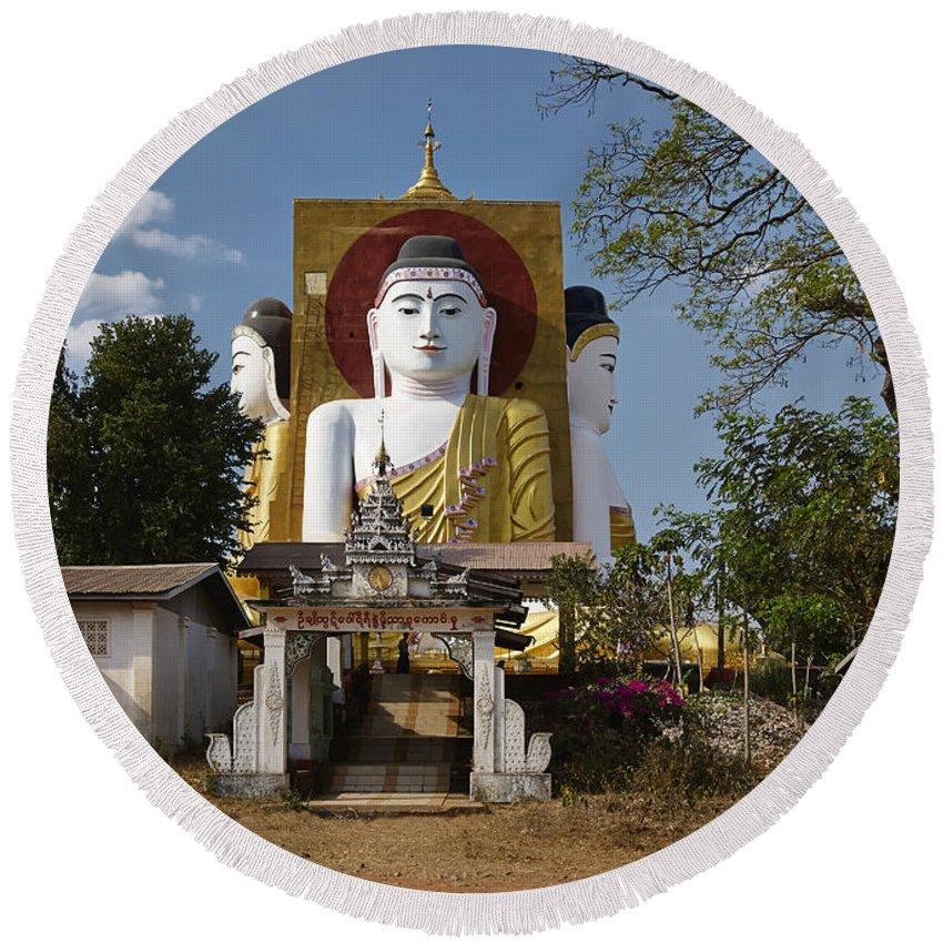 Myanmar Round Beach Towel featuring the photograph four sitting Buddhas 30 metres high looking in four points of the compass at Kyaikpun Pagoda by Juergen Ritterbach