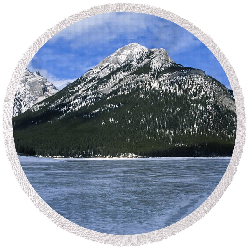 Lake Minnewanka Round Beach Towel featuring the photograph Frozen Minnewanka by Roderick Bley