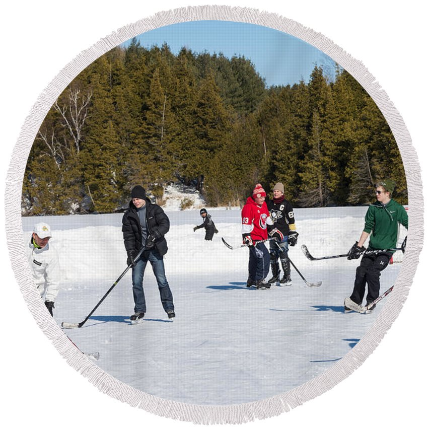 Ice Round Beach Towel featuring the photograph Game Of Ice Hockey On A Frozen Pond by Les Palenik