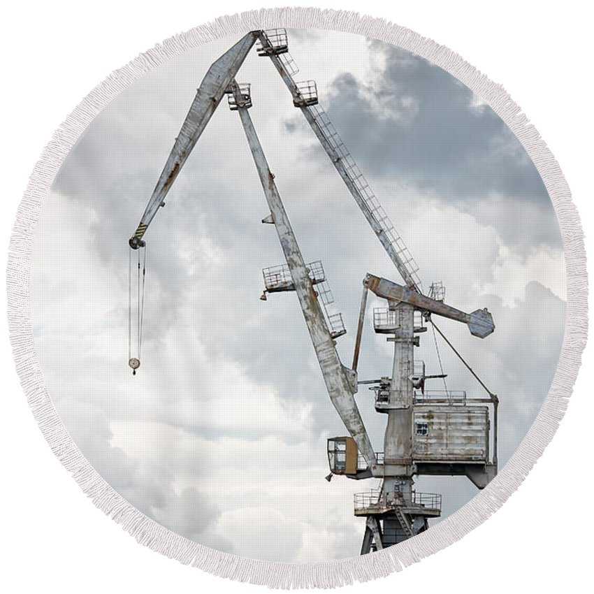 Activity Round Beach Towel featuring the photograph Giant Old Crane Against Dark Sky by Jan Brons