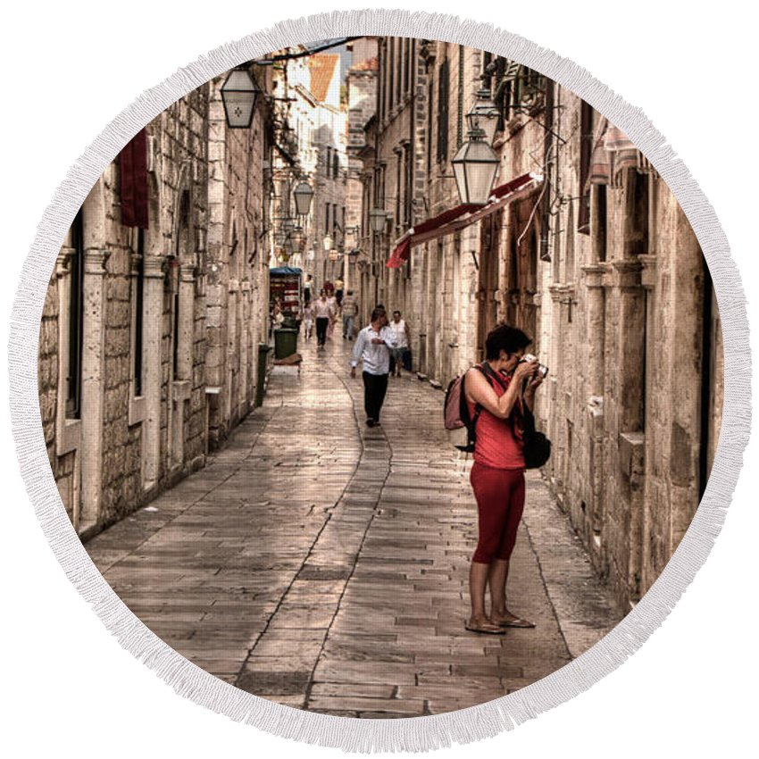 Girl In Red Round Beach Towel featuring the photograph Girl In Red In The White Streets Of Dubrovnik by Weston Westmoreland