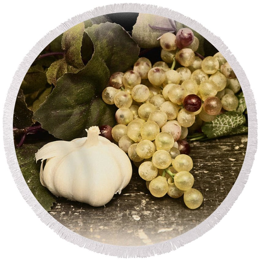 Garlic And Grapes Round Beach Towel featuring the photograph Grapes And Garlic by Bill Cannon