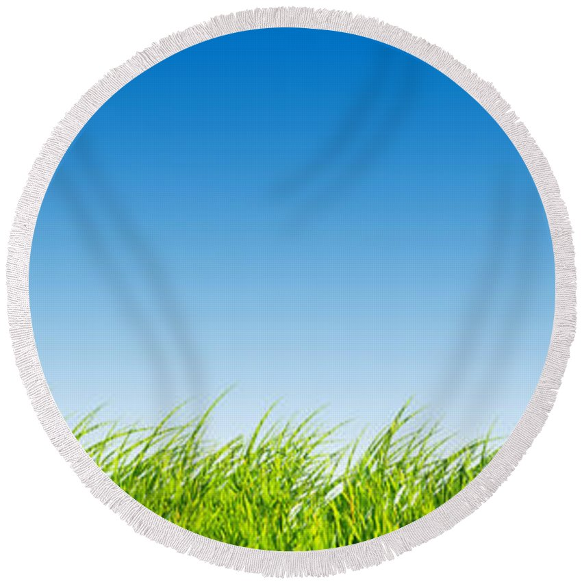 Agriculture Round Beach Towel featuring the photograph Green Fresh Grass On Blue Sky Panorama. by Michal Bednarek