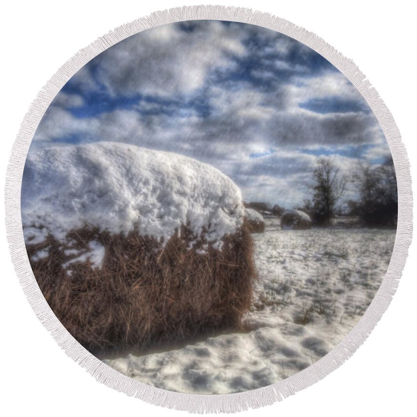 2014 Round Beach Towel featuring the photograph Hay Bale In The Snow by Larry Braun