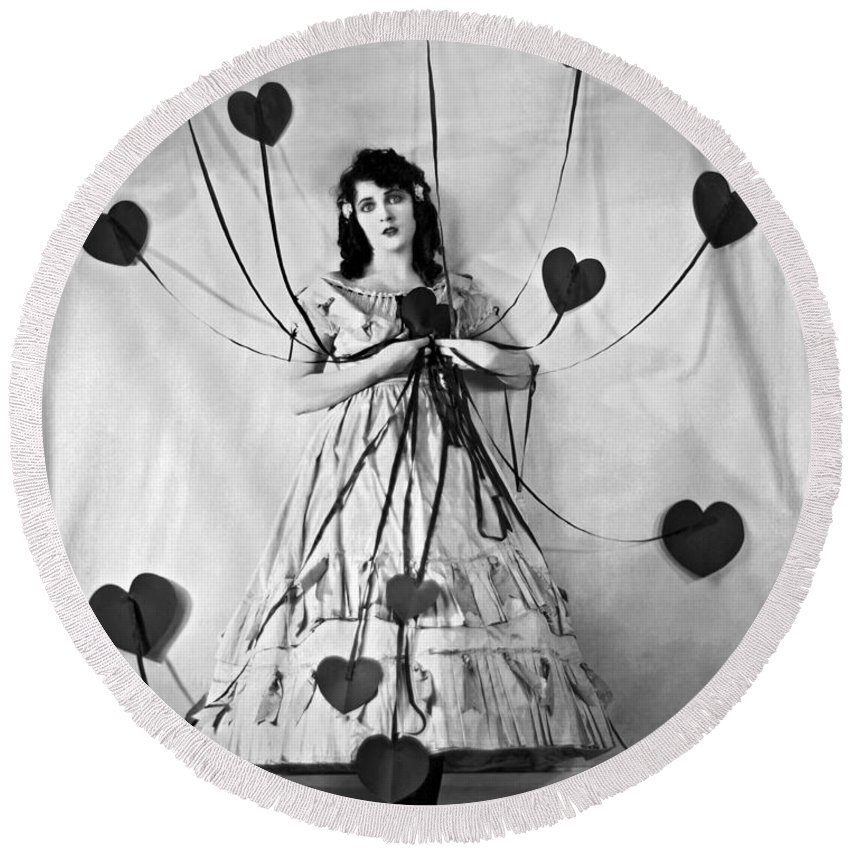 B And W Round Beach Towel featuring the photograph Hearts With Strings Attached by Underwood Archives