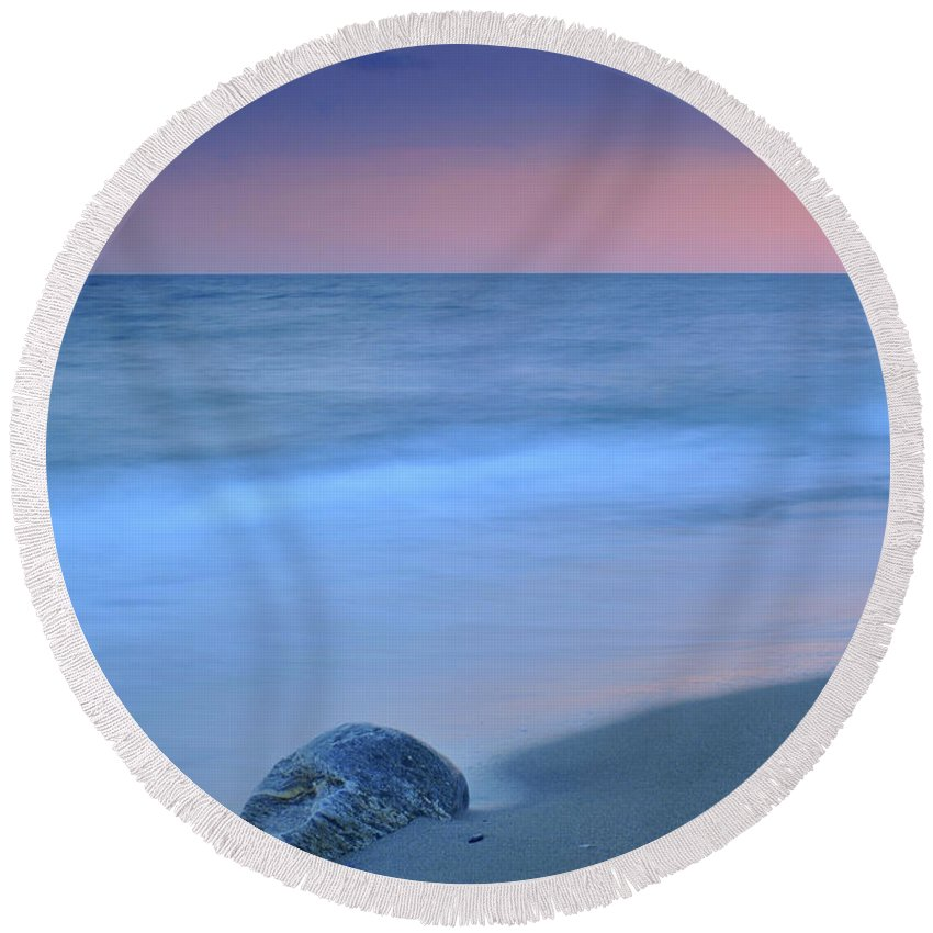 Seascape Round Beach Towel featuring the photograph Hidden Stone At Sunset by Guido Montanes Castillo