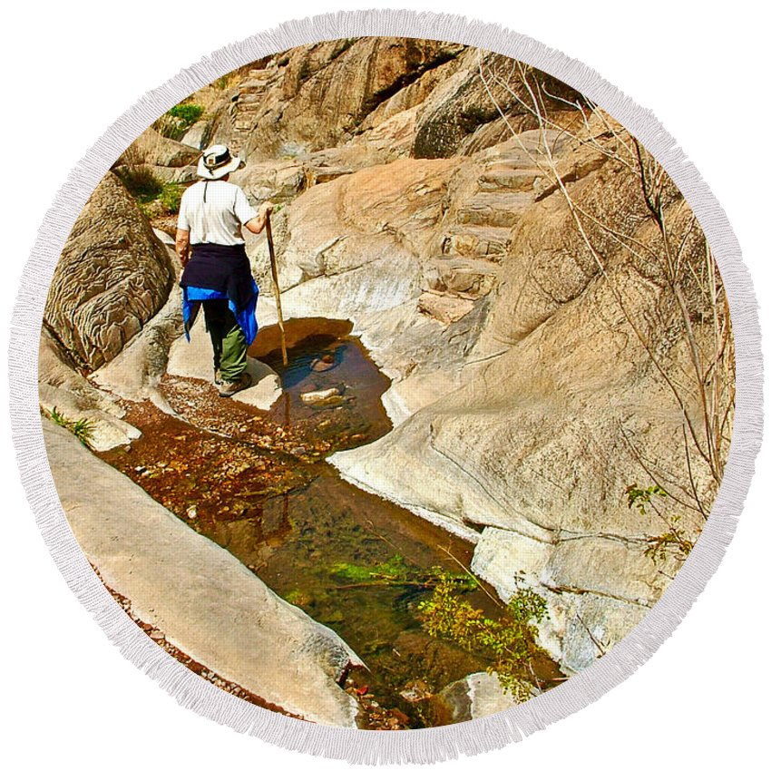 Hiker On Window Trail In Chisos Basin In Big Bend National Park Round Beach Towel featuring the photograph Hiker On Window Trail In Chisos Basin In Big Bend National Park-texas  by Ruth Hager