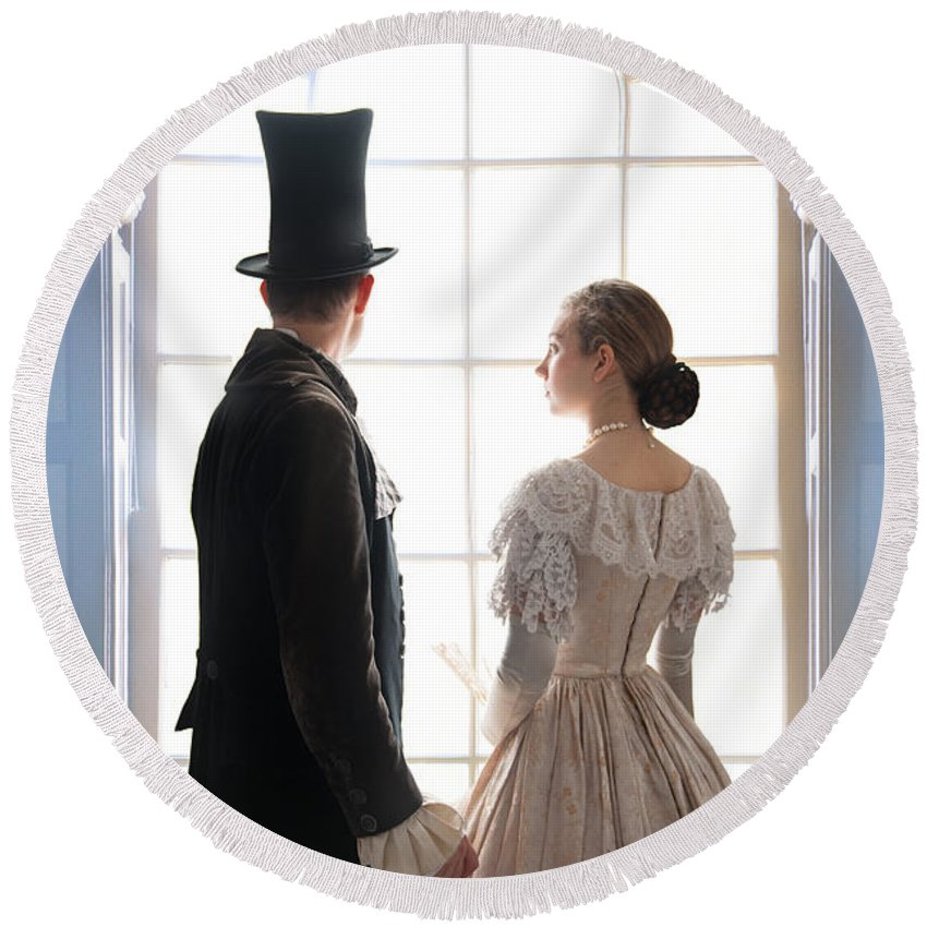 Regency Round Beach Towel featuring the photograph Historical Couple Standing In An Arched Window by Lee Avison