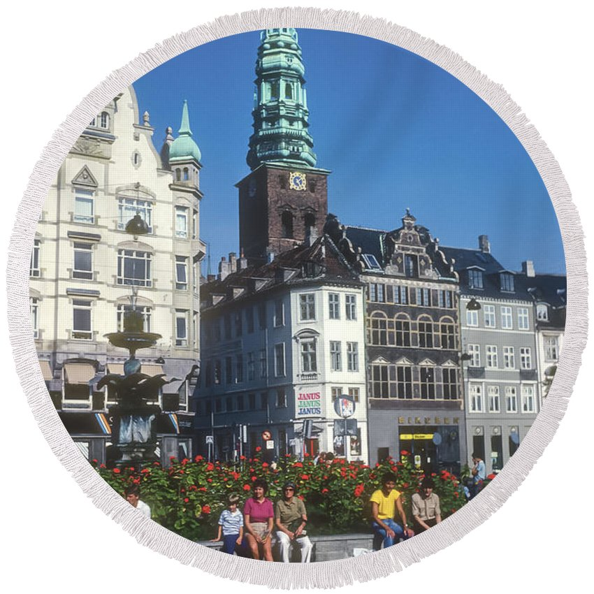 Højbro Hojbro Square Copenhagen Denmark City Squares Cities Cityscape Cityscapes St. Nicholas Church Tower Clock Towers Building Buildings Structures Stork Fountain Fountains People Person Persons Men Man Boy Boys Flower Flowers Creatures Round Beach Towel featuring the photograph Hojbro Square by Bob Phillips