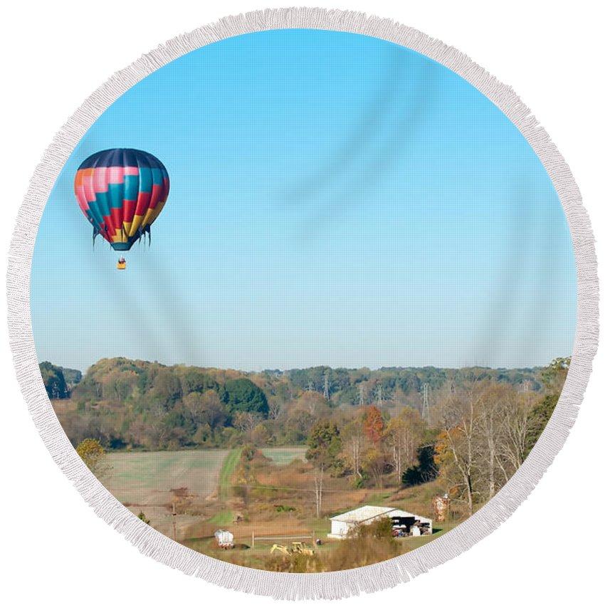 View Round Beach Towel featuring the photograph Hot Air Balloon Over Farm Land by Alex Grichenko