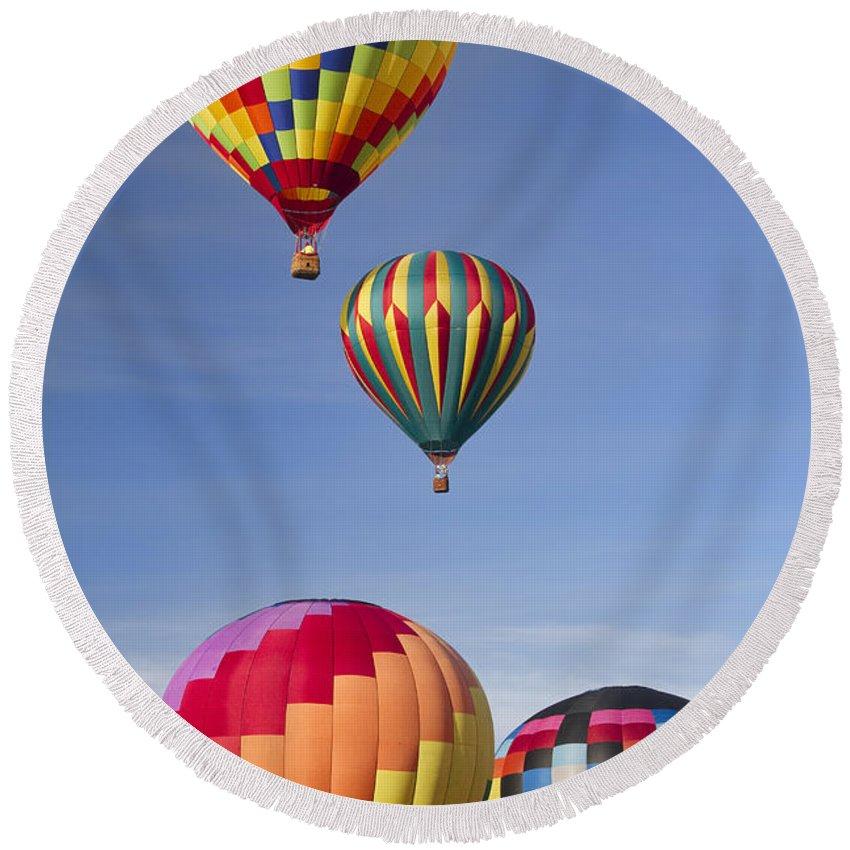 Hot Air Balloons Round Beach Towel featuring the photograph Hot Air Balloon Race by Kathy Clark
