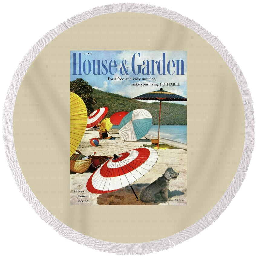 Exterior Round Beach Towel featuring the photograph House And Garden Featuring Umbrellas On A Beach by Otto Maya & Jess Brown