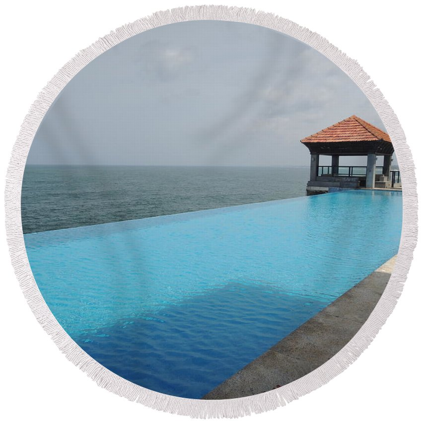 Infinity Pool Round Beach Towel Featuring The Photograph At Leela Kovalam By Mini Arora