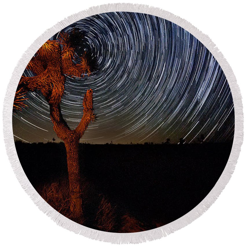 Big Sky Round Beach Towel featuring the photograph Joshua Tree Star Trails by Peter Tellone