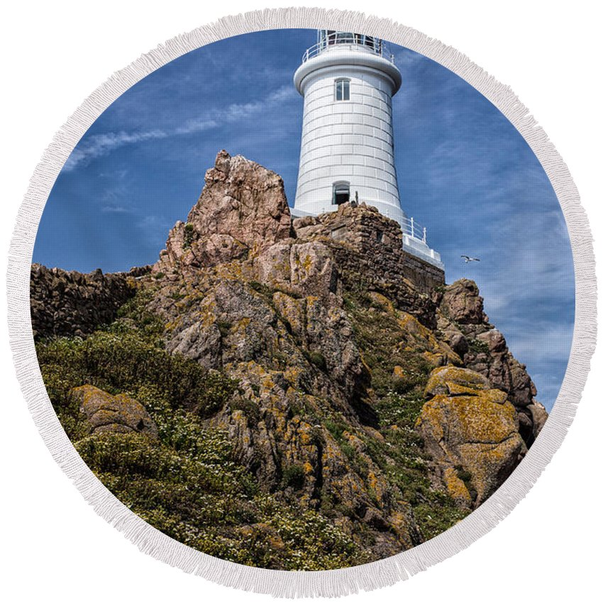 La Corbiere Round Beach Towel featuring the photograph La Corbiere Lighthouse by Nigel R Bell