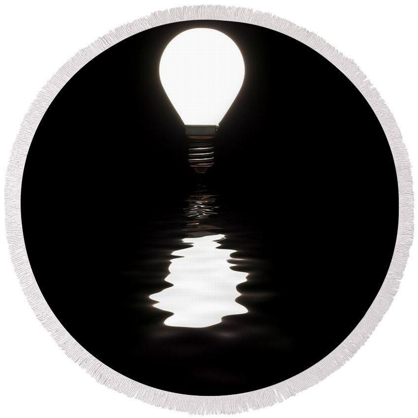 Light Bulb Round Beach Towel featuring the photograph Light Bulb Shining With Reflection In Water On Black by Simon Bratt Photography LRPS