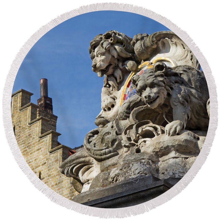 Statue Round Beach Towel featuring the photograph Lion Statue In Bruges by Jaroslav Frank