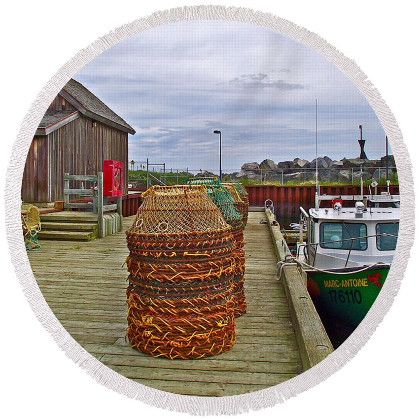 Lobster Fishing Baskets And Boats In Forillon Np Round Beach Towel featuring the photograph Lobster Fishing Baskets And Boats By A Dock In Forillon Np-qc by Ruth Hager