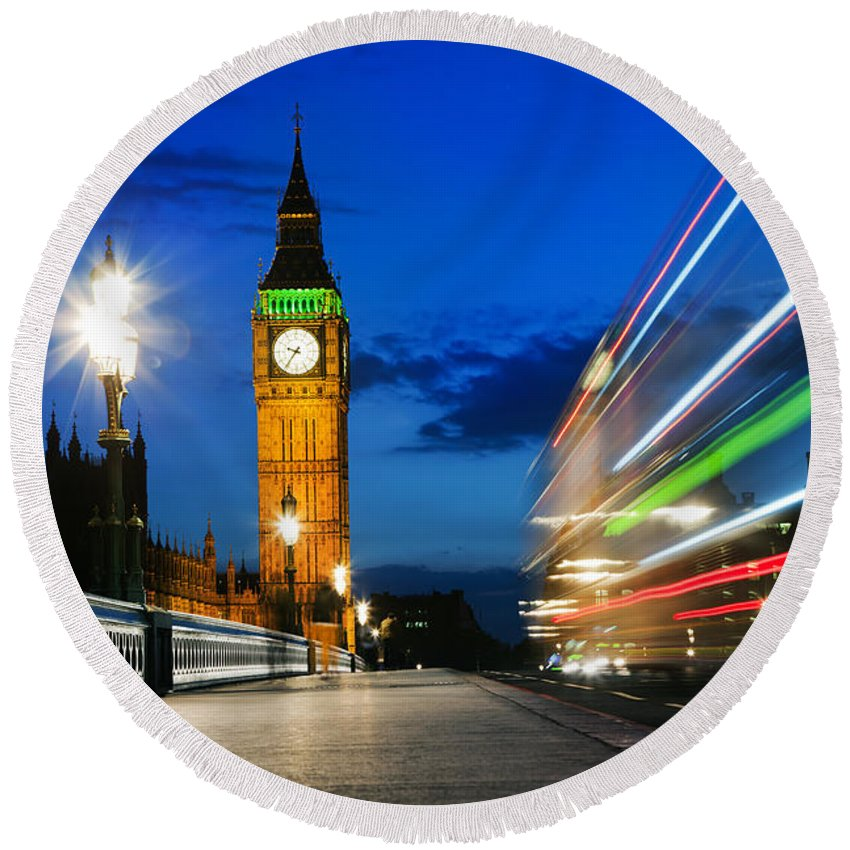 London Round Beach Towel featuring the photograph London Uk Red Bus In Motion And Big Ben At Night by Michal Bednarek