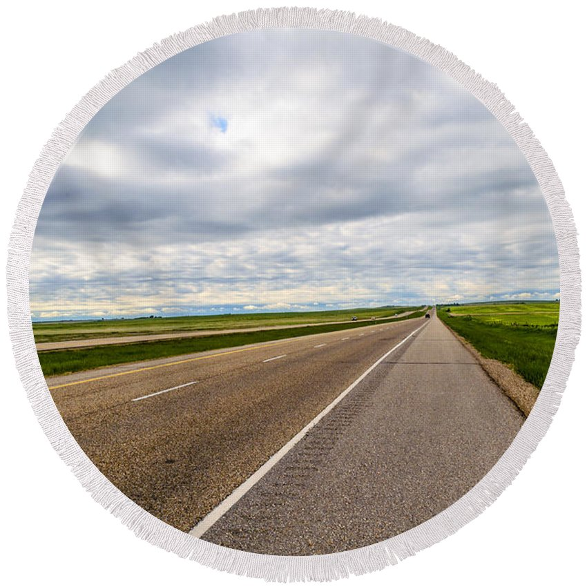Saskatchewan Round Beach Towel featuring the photograph Road To The Sky In Saskatchewan. by Viktor Birkus
