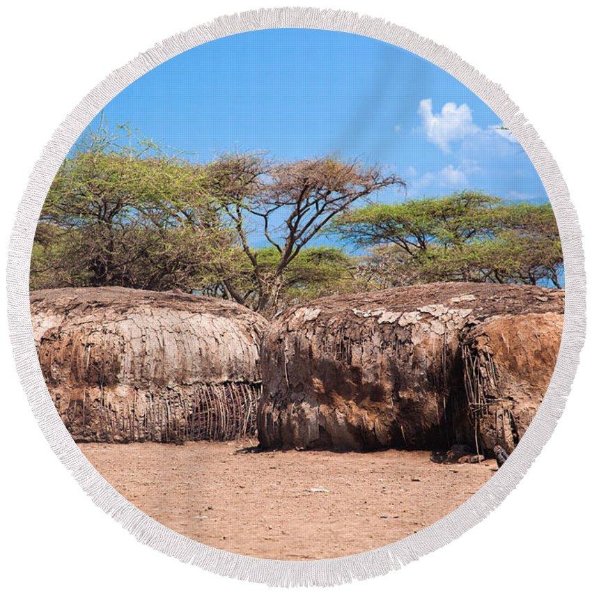 Maasai Round Beach Towel featuring the photograph Maasai Huts In Their Village In Tanzania by Michal Bednarek