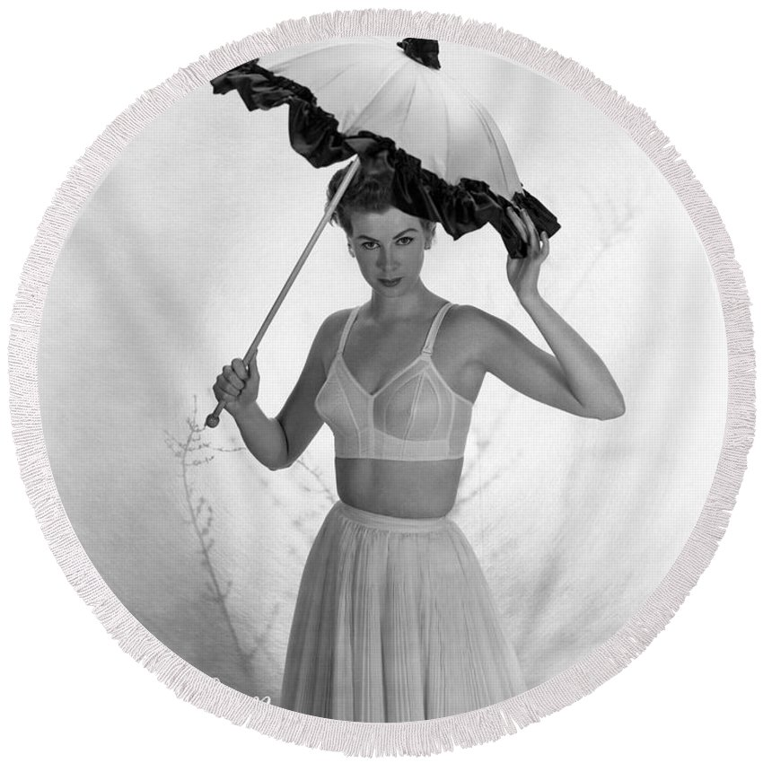 1 Person Round Beach Towel featuring the photograph Maidenform Etude Bra Ad by Underwood Archives
