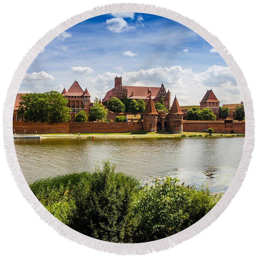 Malbork Round Beach Towel featuring the photograph Malbork Castle by Pati Photography