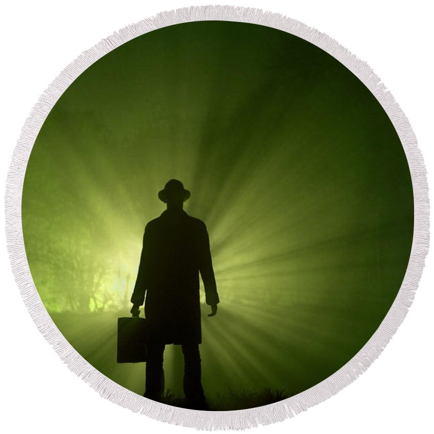 Man Round Beach Towel featuring the photograph Man In Light Beams by Lee Avison