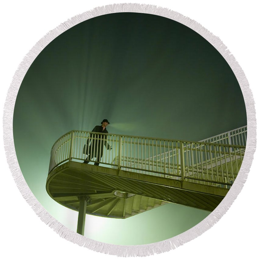 Man Round Beach Towel featuring the photograph Man On Stairs With Case In Fog by Lee Avison